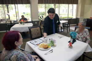 Residents of Esplanade Gardens enjoying a meal in the dining room