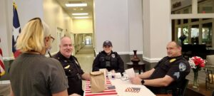 Members of the Converse Police Department visiting with Esplanade Gardens team member, Teresa